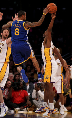 LOS ANGELES - NOVEMBER 21:  Ron Artest #15 of the Los Angeles Lakers blocks a pass attempt by Monta Ellis #8 of the Golden State Warriors at Staples Center on November 21, 2010 in Los Angeles, California. The Lakers won 117-89. NOTE TO USER: User expressl