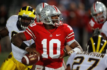 COLUMBUS, OH - NOVEMBER 18:  Quarterback Troy Smith #10 of the Ohio State Buckeyes throws a 3 quarter interception under pressure from the Michigan Wolverines defense November 18, 2006 at Ohio Stadium in Columbus, Ohio.  (Photo by Gregory Shamus/Getty Ima