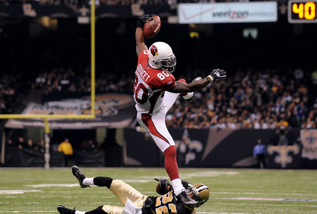 NEW ORLEANS - JANUARY 16:  Early Doucet #80 of the Arizona Cardinals takes the ball down to the 5 yard line on a reception in the first half against Tracy Porter #22 of the New Orleans Saints during the NFC Divisional Playoff Game at Louisana Superdome on