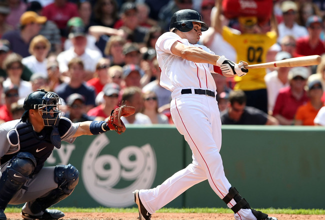 BOSTON - JULY 05:  Jacoby Ellsbury #46 of the Boston Red Sox hits a solo home run in the sixth inning as Kenji Johjima #2 of the Seattle Mariners defends on July 5, 2009 at Fenway Park in Boston, Massachusetts.  (Photo by Elsa/Getty Images)