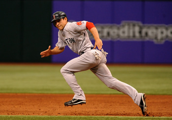 ST. PETERSBURG, FL - MAY 3: Outfielder Jacoby Ellsbury #46 of the Boston Red Sox attempts a steal against the Tampa Bay Rays May 3, 2009 at Tropicana Field in St. Petersburg, Florida. (Photo by Al Messerschmidt/Getty Images)