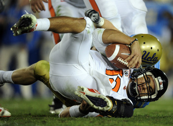 PASADENA, CA - NOVEMBER 06:  Ryan Katz #12 of the Oregon State Beavers is sacked by Sean Westgate #11 of the UCLA Bruins during the fourth quarter at the Rose Bowl on November 6, 2010 in Pasadena, California.  (Photo by Harry How/Getty Images)