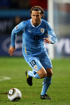 PORT ELIZABETH, SOUTH AFRICA - JULY 10:  Diego Forlan of Uruguay in action during the 2010 FIFA World Cup South Africa Third Place Play-off match between Uruguay and Germany at The Nelson Mandela Bay Stadium on July 10, 2010 in Port Elizabeth, South Afric