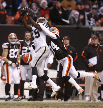 CLEVELAND - DECEMBER 27:  Johnnie Lee Higgins #15 of the Oakland Raiders makes a catch over Eric Wright #24 of the Cleveland Browns at Cleveland Browns Stadium on December 27, 2009 in Cleveland, Ohio.  (Photo by Matt Sullivan/Getty Images)