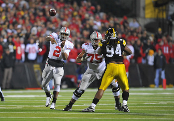IOWA CITY, IA - NOVEMBER 20:  Quarterback Terrelle Pryor #2 of the Ohio State Buckeyes throws under pressure from defensive end Adrian Clayborn #94 of the University of Iowa Hawkeyes as offensive lineman Mike Adams #75 defends during the second half of pl