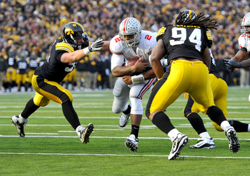 IOWA CITY, IA - NOVEMBER 20: Defeisive linemen Karl Klug #95 and Adrian Clayborn #94 of the University of Iowa Hawkeyes close in for the tackle on quarterback Terrelle Pryor #2 of the Ohio State Buckeyes as he drive the ball towards the goal line during t