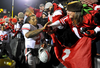 IOWA CITY, IA - NOVEMBER 20: Quarterback Terrelle Pryor #2 of the Ohio State Buckeyes celebrates with fans after beating the University of Iowa Hawkeyes at Kinnick Stadium on November 20, 2010 in Iowa City, Iowa. Ohio State won 20-17 over Iowa. (Photo by