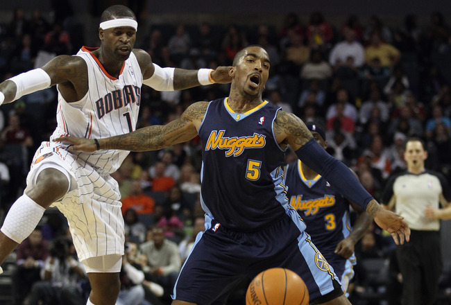 CHARLOTTE, NC - DECEMBER 07:  J.R. Smith #5 of the Denver Nuggets collides with Stephen Jackson #1 of the Charlotte Bobcats during their game at Time Warner Cable Arena on December 7, 2010 in Charlotte, North Carolina.  NOTE TO USER: User expressly acknow