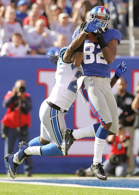 EAST RUTHERFORD, NJ - OCTOBER 17: Mario Manningham #82 of the New York Giants catches for a touchdown under pressure from Jonathan Wade #24 of the Detroit Lions at New Meadowlands Stadium on October 17, 2010 in East Rutherford, New Jersey.  (Photo by Nick
