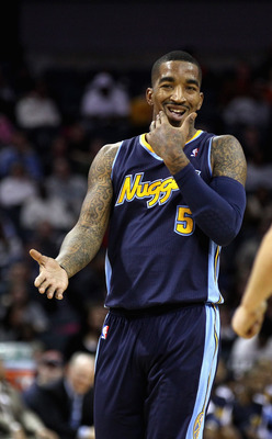 CHARLOTTE, NC - DECEMBER 07:  J.R. Smith #5 of the Denver Nuggets holds his jaw as he reacts to a call against the Charlotte Bobcats during their game at Time Warner Cable Arena on December 7, 2010 in Charlotte, North Carolina.  NOTE TO USER: User express