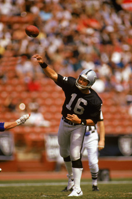 LOS ANGELES - 1985:  Jim Plunkett #16 of the Los Angeles Raiders passes the ball against the New York Giants at the Los Angeles Coliseum in Los Angeles, California. The Giants defeated the Raiders 14-9. (Photo by Mike Powell/Getty Images)
