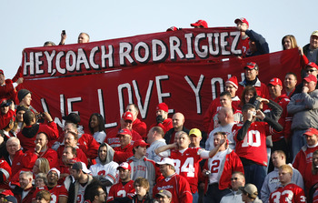 ANN ARBOR, MI - NOVEMBER 21: Fans of the Ohio State Buckeyes hold up a sign in support of head coach Rich Rodriguez of the Michigan Wolverines on November 21, 2009 at Michigan Stadium in Ann Arbor, Michigan. Ohio State won the game 21-10. (Photo by Gregor