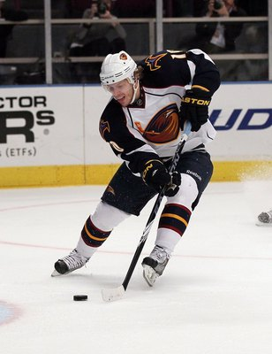 NEW YORK - OCTOBER 27:  Bryan Little #10 of the Atlanta Thrashers skates against the New York Rangers on October 27, 2010 at Madison Square Garden in New York City. Atlanta defeated the Rangers 6-4.  (Photo by Jim McIsaac/Getty Images)