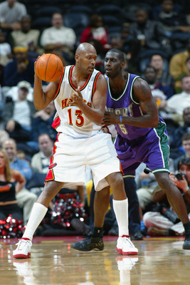 ATLANTA - DECEMBER 5:  Glenn Robinson #13 of the Atlanta Hawks is defended by Tim Thomas #5 of the Milwaukee Bucks during the NBA game at Phillips Arena on December 5, 2002 in Atlanta, Georgia.  The Hawks won 98-80.  NOTE TO USER: User expressly acknowled