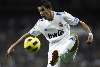 MADRID, SPAIN - NOVEMBER 20:  Angel Di Maria of Real Madrid controls the ball during the La Liga match between Real Madrid and Athletic Bilbao at Estadio Santiago Bernabeu on November 20, 2010 in Madrid, Spain. Real Madrid won 5-1.  (Photo by Manuel Queim