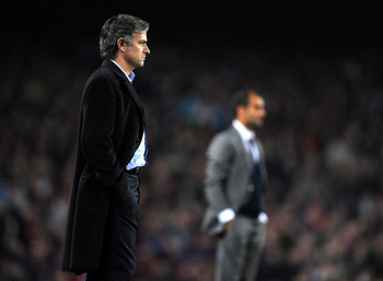 BARCELONA, SPAIN - NOVEMBER 24:  Coach Jose Mourinho of Inter Milan follows his players backdropped by coach Josep Guardiola of FC Barcelona during the UEFA Champions League group F match between FC Barcelona and Inter Milan at the Camp Nou Stadium on Nov