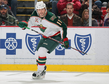 DETROIT, MI - NOVEMBER 19:  John Madden #11 of the Minnesota Wild skates in a game against the Detroit Red Wings on November 19, 2010 at the Joe Louis Arena in Detroit, Michigan. The Wild defeated the Wings 4-3 in overtime. (Photo by Claus Andersen/Getty