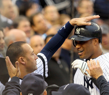 NEW YORK - OCTOBER 20:  Robinson Cano #24 and Derek Jeter #2 (L) of the New York Yankees celebrate in the dugout after Cano hit a solo home run in the third inning against the Texas Rangers in Game Five of the ALCS during the 2010 MLB Playoffs at Yankee S
