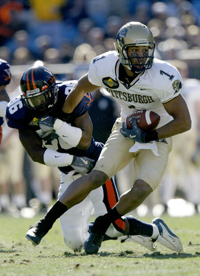 CHARLOTTE, NC - DECEMBER 27:  Larry Fitzgerald #1 of the Pittsburgh Panthers runs by Jermaine Hardy #36 of the Virginia Cavaliers during the Continental Tire Bowl December 27, 2003 at Ericsson Stadium in Charlotte, North Carolina.  (Photo by Craig Jones/G