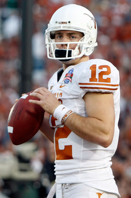PASADENA, CA - JANUARY 07:  Quarterback Colt McCoy #12 of the Texas Longhorns looks on before taking on the Alabama Crimson Tide in the Citi BCS National Championship game at the Rose Bowl on January 7, 2010 in Pasadena, California.  (Photo by Jeff Gross/