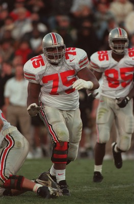 19 Oct 1996:  Offensive lineman Orlando Pace #75 of the Ohio State Buckeyes in action on the field as he leads through a hole in the offensive line to make a block during a play in the Buckeyes 42-14 victory over the Purdue Boilermakers at Ross Ade Stadiu
