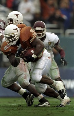 1 Jan 1999: Ricky Williams #34 of the Texas Longhorns carries the ball during the Southwest Bell Cotton Bowl against the Mississippi State Bulldogs at the Cotton Bowl in Dallas, Texas. Texas defeated Mississippi St 38-11. Mandatory Credit: Brian Bahr  /Al
