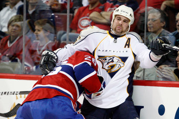 MONTREAL- NOVEMBER 18:  Josh Gorges #26 of the Montreal Canadiens body checks Steve Sullivan #26 of the Nashville Predators during the NHL game at the Bell Centre on November 18, 2010 in Montreal, Quebec, Canada.  (Photo by Richard Wolowicz/Getty Images)