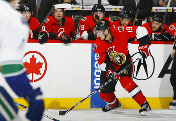 OTTAWA, CANADA - NOVEMBER 11:  Jason Spezza #19 of the Ottawa Senators carries the puck up the far boards during a game against the Vancouver Canucks at Scotiabank Place on November 11, 2010 in Ottawa, Ontario, Canada.  (Photo by Phillip MacCallum/Getty I