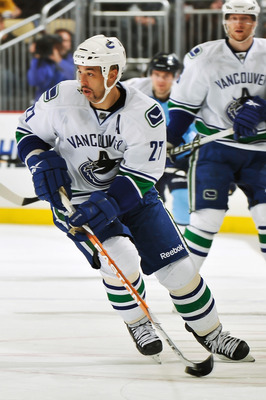 PITTSBURGH - NOVEMBER 17:  Manny Malhotra #27 of the Vancouver Canucks skates with the puck against the Pittsburgh Penguins on November 17, 2010 at Consol Energy Center in Pittsburgh, Pennsylvania.  (Photo by Jamie Sabau/Getty Images)
