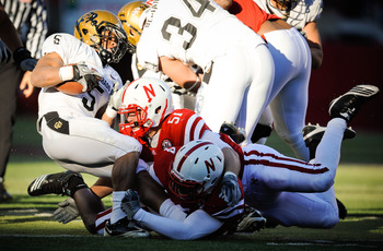 LINCOLN, NE - NOVEMBER 26: Lavonte David #4 and Will Compton #51 of the Nebraska Cornhuskers bring down Rodney Stewart #5 of the Colorado Buffaloes during the first half of their game at Memorial Stadium on November 26, 2010 in Lincoln, Nebraska.  (Photo