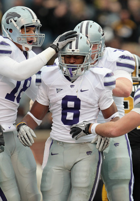 COLUMBIA, MO - NOVEMBER 13:  Running back Daniel Thomas #8 of the Kansas State Wildcats is congratulated after scoring a touchdown during the game against the Missouri Tigers on November 13, 2010 at Faurot Field/Memorial Stadium in Columbia, Missouri.  (P