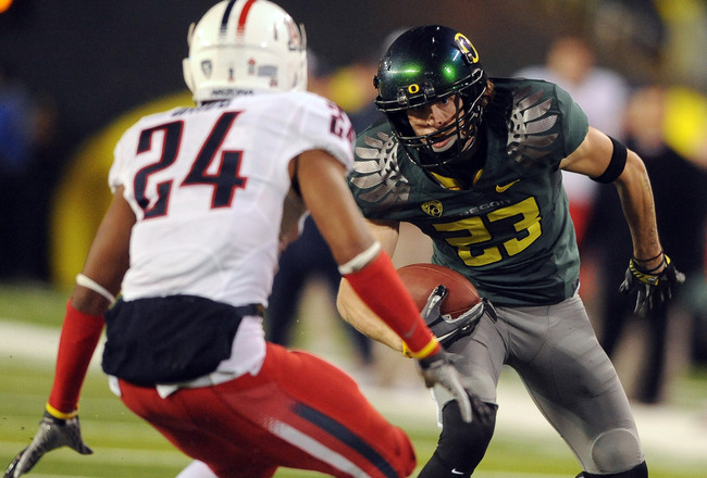 EUGENE, OR - NOVEMBER 26: Wide receiver Jeff Maehl #23 of the Oregon Ducks puts a move on cornerback Trevin Wade #24 of the Arizona Wildcats in the fourth quarter of the game at Autzen Stadium on November 26, 2010 in Eugene, Oregon. The Ducks won the game