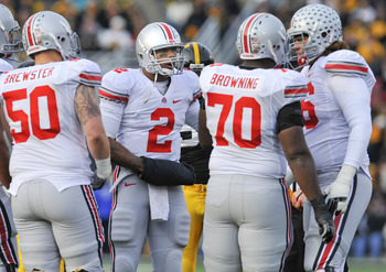 IOWA CITY, IA - NOVEMBER 20:  Quarterback Terrelle Pryor #2 of the Ohio State Buckeyes talks with teammates in the huddle during the play against the University of Iowa Hawkeyes at Kinnick Stadium on November 20, 2010 in Iowa City, Iowa. Ohio State won 20