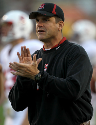 TEMPE, AZ - NOVEMBER 13:  Head coach Jim  Harbaugh of the Stanford Cardinal cheers his team on as they warm up for the game with the Arizona State Sun Devils  at Sun Devil Stadium on November 13, 2010 in Tempe, Arizona. (Photo by Stephen Dunn/Getty Images