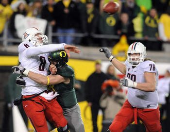 EUGENE, OR - NOVEMBER 26: Defensive end Brandon Bair #88 of the Oregon Ducks hits quarterback Nick Foles #8 of the Arizona Wildcats in the fourth quarter of the game at Autzen Stadium on November 26, 2010 in Eugene, Oregon.The Ducks won the game 48-29. (P