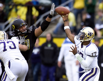 EUGENE, OR - NOVEMBER 06: Defensive tackle Ricky Heimuli #90 of the Oregon Ducks knocks down the pass of quarterback Keith Price #17 of the Washington Huskies in the fourth quarter of the game at Autzen Stadium on November 6, 2010 in Eugene, Oregon. The D