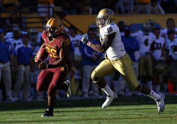 TEMPE, AZ - NOVEMBER 26:  Runningback Cameron Marshall #26 of the Arizona State Sun Devils carries the football for a 71 yard rushing touchdown past Ryan Sublett #10 of the UCLA Bruins during the thrid quarter of the college football game at Sun Devil Sta