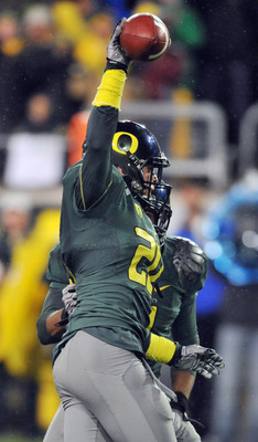 EUGENE, OR - NOVEMBER 26: Free safety John Boyett #20 of the Oregon Ducks celebrates an interception in the first quarter of the game against the Arizona Wildcats at Autzen Stadium on November 26, 2010 in Eugene, Oregon. The Ducks won the game 48-29.  (Ph
