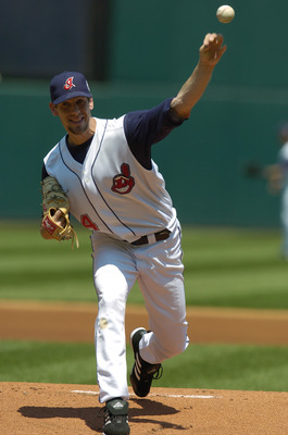 CLEVELAND - JULY 11:  Cliff Lee #34 of the Cleveland Indians pitches against the Oakland Athletics during the game on July 11, 2004 at Jacobs Field in Cleveland, Ohio.  The Indians defeated the A's 4-1.  (Photo by David Maxwell/Getty Images)