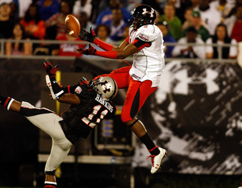 ORLANDO, FL - JANUARY 04:  Receiver Alshon Jeffrey #1 hauls in a pass as cornerback Travis Hawkins #11 looks to break up the pass during the All America Under Armour Football Game at the Florida Citrus Bowl on January 4, 2009 in Orlando, Florida.  (Photo