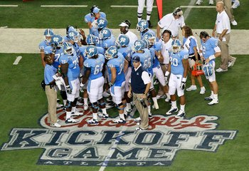 ATLANTA - SEPTEMBER 04:  Head coach Butch Davis and the offense of the North Carolina Tar Heels against the LSU Tigers during the Chick-fil-A Kickoff Game at Georgia Dome on September 4, 2010 in Atlanta, Georgia.  (Photo by Kevin C. Cox/Getty Images)