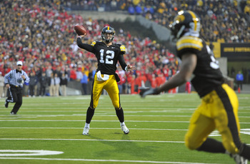 IOWA CITY, IA - NOVEMBER 20:  Quarterback Ricky Stanzi #12 of the University of Iowa Hawkeyes throws down field to running back Adam Robinson #32 during the second half of play against the Ohio State Buckeyes at Kinnick Stadium on November 20, 2010 in Iow