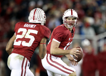 PALO ALTO, CA - NOVEMBER 27:  Andrew Luck #12 of the Stanford Cardinal pitches the ball to Tyler Gaffney #25 during their game against the Oregon State Beavers at Stanford Stadium on November 27, 2010 in Palo Alto, California.  (Photo by Ezra Shaw/Getty I