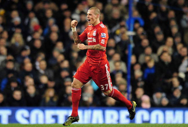 LONDON, ENGLAND - NOVEMBER 28:  Martin Skrtel of Liverpool celebrates scoring the opening goal during the Barclays Premier League match between Tottenham Hotspur and Liverpool at White Hart Lane on November 28, 2010 in London, England.  (Photo by Shaun Bo