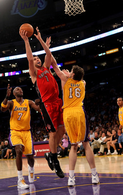 LOS ANGELES - NOVEMBER 5:  Andrea Bargnani #7 of the Toronto Raptors shoots over Pau Gasol #16 and Lamar Odom #7 of the Los Angeles Lakers at Staples Center on November 5, 2010 in Los Angeles, California.  The Lakers won 108-102.   NOTE TO USER: User expr