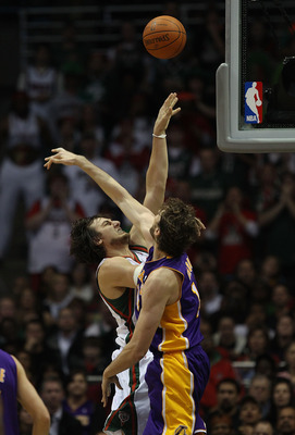 MILWAUKEE - NOVEMBER 16: Andrew Bogut #6 of the Milwaukee Bucks puts up a shot over Pau Gasol #16 of the Los Angeles Lakers at the Bradley Center on November 16, 2010 in Milwaukee, Wisconsin. NOTE TO USER: User expressly acknowledges and agrees that, by d