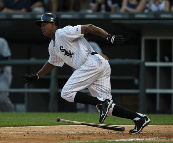 CHICAGO - JULY 26: Juan Pierre #1 of the Chicago White Sox runs after hitting the ball against the Seattle Mariners at U.S. Cellular Field on July 26, 2010 in Chicago, Illinois. The White Sox defeated the Mariners 6-1. (Photo by Jonathan Daniel/Getty Imag