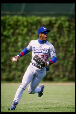 11 May 1993:  Outfielder Eric Davis of the Los Angeles Dodgers looks to throw the ball during a game against the Chicago Cubs at Wrigley Field in Chicago, Illinois. Mandatory Credit: Jonathan Daniel  /Allsport