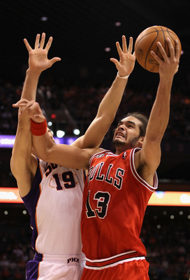 PHOENIX - NOVEMBER 24:  Joakim Noah #13 of the Chicago Bulls puts up a shot over Hedo Turkoglu #19 of the Phoenix Suns during the NBA game at US Airways Center on November 24, 2010 in Phoenix, Arizona. NOTE TO USER: User expressly acknowledges and agrees