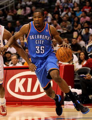 LOS ANGELES - NOVEMBER 3:  Kevin Durant #32 of the Oklahoma City Thunder drives past Ryan Gomes #15 of the Los Angeles Clippers at Staples Center on November 3, 2010 in Los Angeles, California.  NOTE TO USER: User expressly acknowledges and agrees that, b